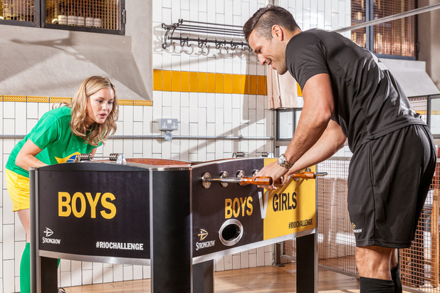 Caggie Dunlop takes on Mark Wright in a game of male v female table football - 5 June 2014