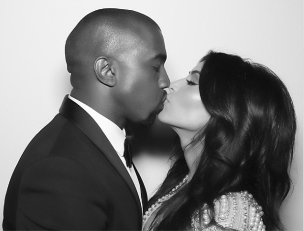 Kim Kardashian posts picture of herself kissing Kanye on their wedding day, 8 June 2014