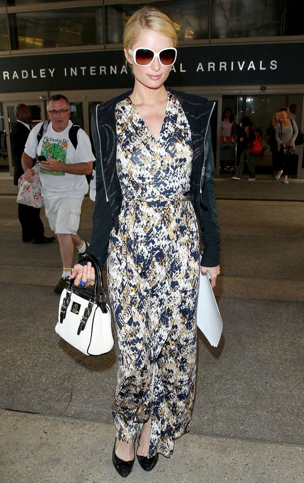 Paris Hilton wears a printed maxi dress while arriving at Los Angeles International Airport in America, 29 May 2014