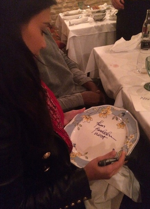 Kim Kardashian West signs her new signature for the first time. She signed a plate in Prague at a restaurant while on honeymoon, June 2014