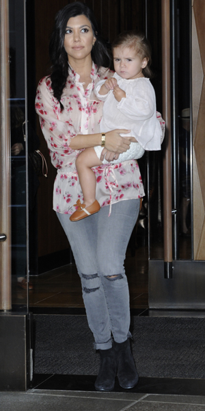Kourtney Kardashian leaving a hotel in New York City with daughter Penelope, 3 June 2014
