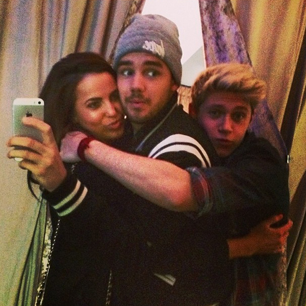 Liam Payne and girlfriend Sophia Smith are photobombed by Niall Horan, 31 May 2014