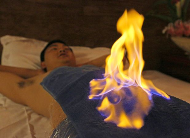 Anonymous man, enjoying a fire spa