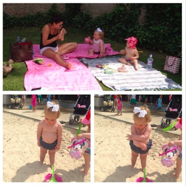 Imogen Thomas enjoys a picnic with daughter Ariana, 13 June 2014