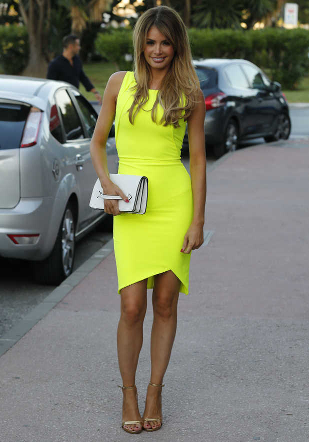 TOWIE's Chloe Sims wears a neon yellow dress by Celeb Boutique while in Marbella, Spain - 7 June 2014