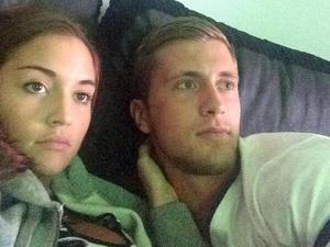 Jacqueline Jossa and Dan Osborne cuddle up on the sofa watching football. 19 June 2014.