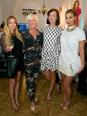 TOWIE's Ferne McCann, Robyn Althasen and Imogen Leaver pose with Fiona Lambert (vice president of George) at the AW14 George catwalk show (18 June).
