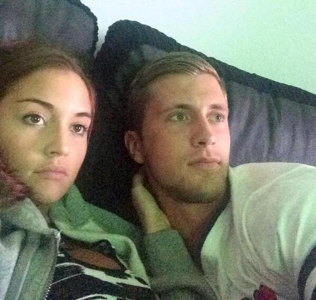 Jacqueline Jossa and Dan Osborne cuddle up on the sofa watching football. 19 June 2014.