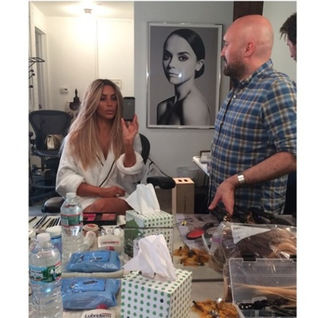 Kim Kardashian shows off her new blonde hair, courtesy of Serge Normant, 25 June 2014