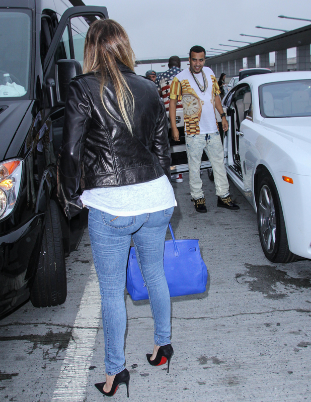 Khloe Kardashian and French Montana at an airport in New York, 24 June 2014