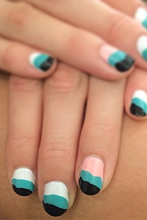Pixie Lott shows off a white, pink, green and black manicure in an Instagram picture - 2 July 2014