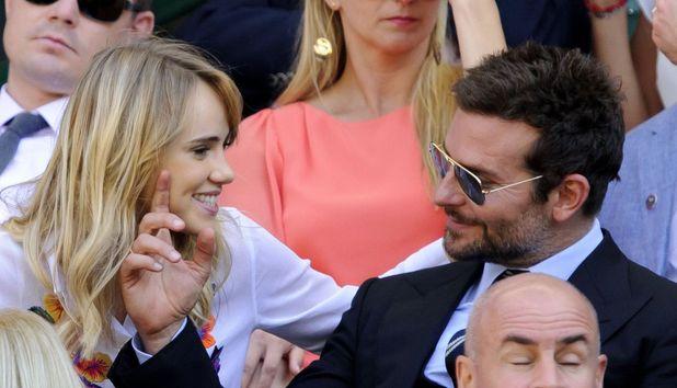 Bradley Cooper and Suki Waterhouse at Wimbledon, London, 4 July