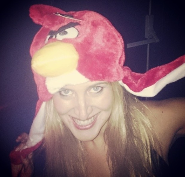 Cheska Hull wears an angry bird hat on a night out, June 2014.
