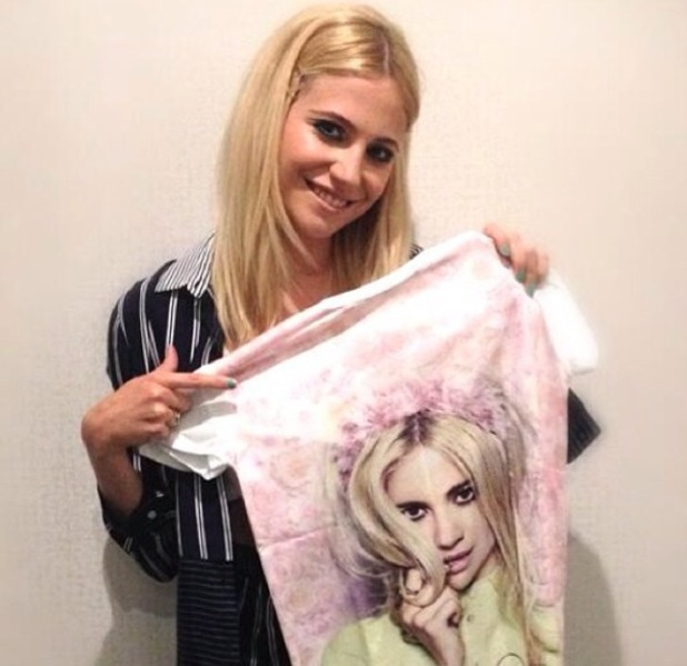 Pixie Lott holds up t-shirt of Pixie Lott! 18 June 2014
