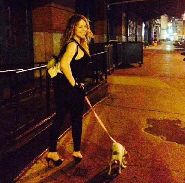 Mariah Carey goes for an early morning stroll with her dog (1 July).