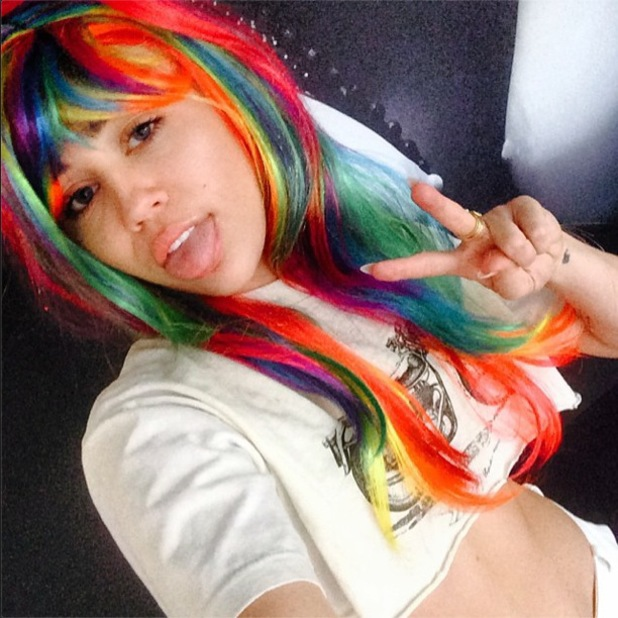 Miley Cyrus wears a rainbow wig in an Instagram picture - 30 June 2014