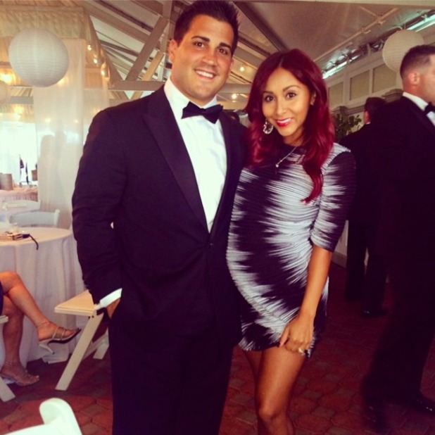 Nicole Polizzi, aka Jersey Shore's Snooki, shows off baby bump in new Instagram pictures, 4 July 2014