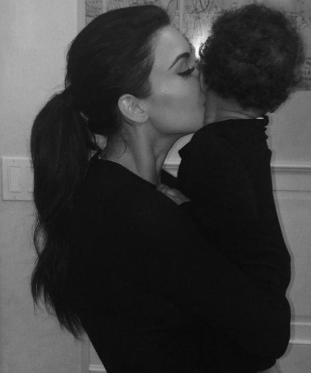 Kim Kardashian cuddles baby North at bedtime - 2 July 2014