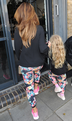 Katie Price and her daughter Princess Tiaamii arriving at Fubar Radio in London, wearing identical patterned trousers 07/08/2014 London, United Kingdom
