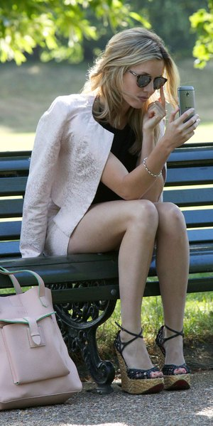 Caggie Dunlop poses for a selfie in the park, London, 8 July
