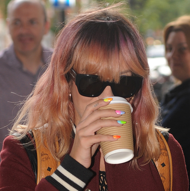 Lily Allen arrives at Radio 1 with multi coloured nails, 15 July 2014