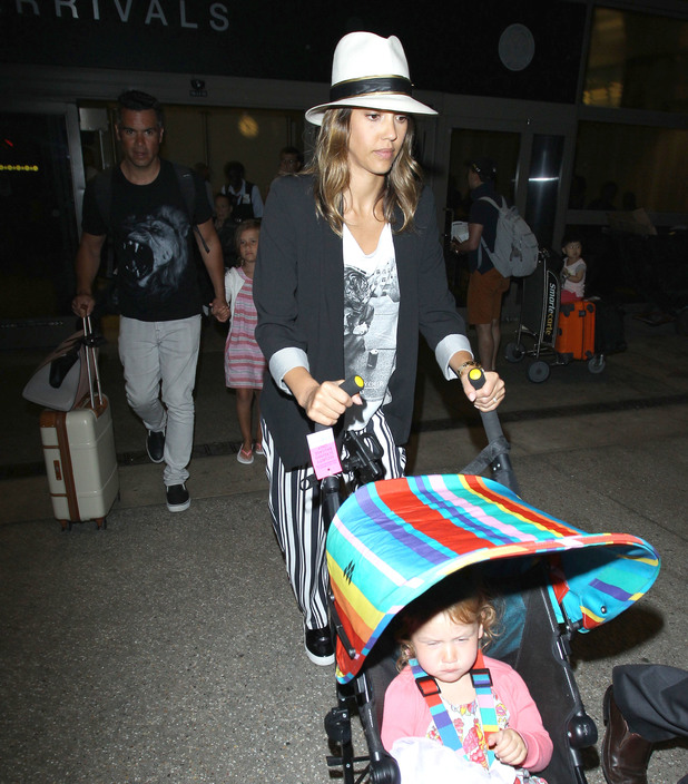 Jessica Alba and family land at LAX airport, LA, 15 July