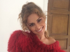 Cheryl Cole beams in fluffy red jumper after UK wedding celebration