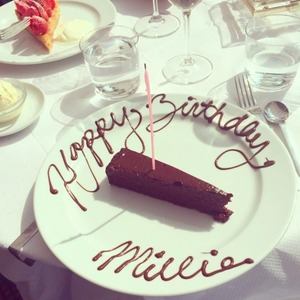 Millie Mackintosh enjoys a slither of chocolate cake for her 25th birthday, 26 July 2014