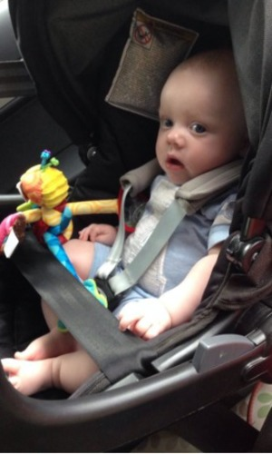 Michelle Heaton's baby boy in the back other car, July 2014.