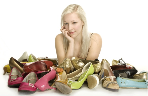 Woman with pile of shoes