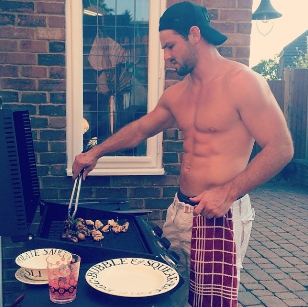 Una Healy's husband Ben goes topless to make their BBQ, July 2014.