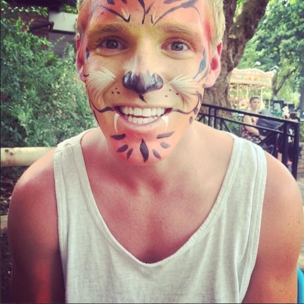 Made In Chelsea's Jamie Laing gets a tiger face paint while at the zoo (24 July).