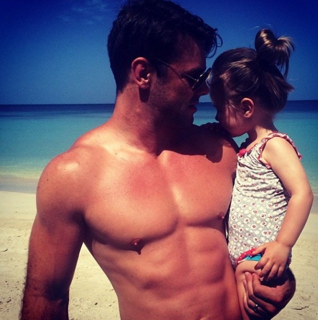 Ben Foden poses with daughter Aoife on the beach, July 2014.