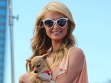 Paris Hilton looked summer-ready in a peach dress while filming a TV appearance.