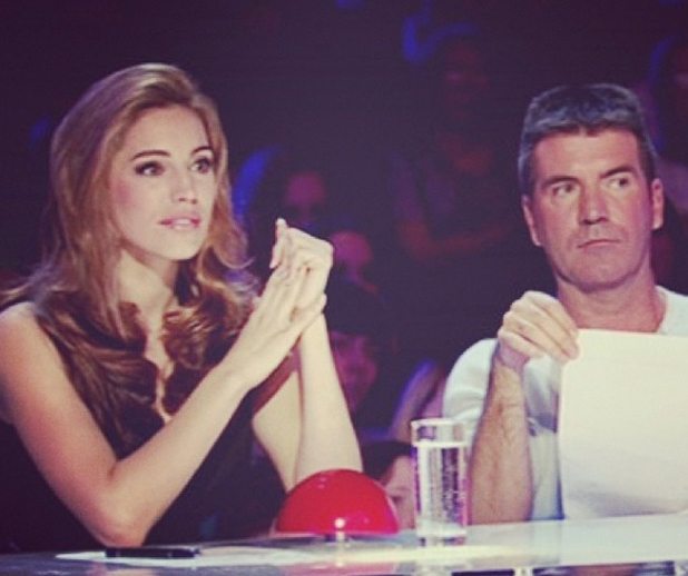 "Kelly Brook and Simon Cowell on BGT. Kelly posted this as a ThrowbackThursday shot with the hashtag: ""Sacked."" 24 July 2014"