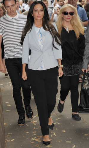 Tulisa Contostavlos reading a statement outside Southwark Crown Court after charges against her were dropped, 21 July 2014