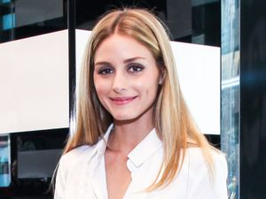Olivia Palermo teams white shirt with camo shorts at store opening