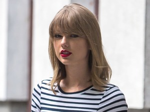 Taylor Swift shows off her endless legs in striped dress while in New York