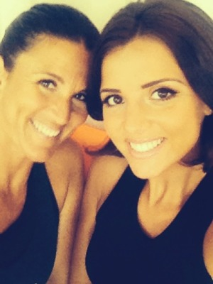 Lucy Mecklenburgh poses with her personal trainer, Aug 2014.