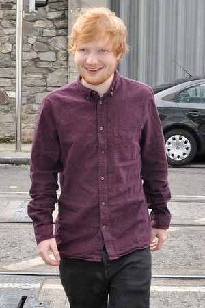 Ed Sheeran signs autographs and poses for photographs with fans during a radio promo tour. 31 July 2014.