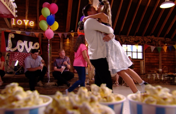 Lauren Pope and Lewis Bloor share a romantic embrace at the Grease-themed party. TOWIE series finale episode airs Wednesday 30 July 2014.