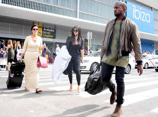 Kris Jenner and Kim Kardashian and Kanye West arriving at Ibiza airport, Spain - 01 Aug 2014