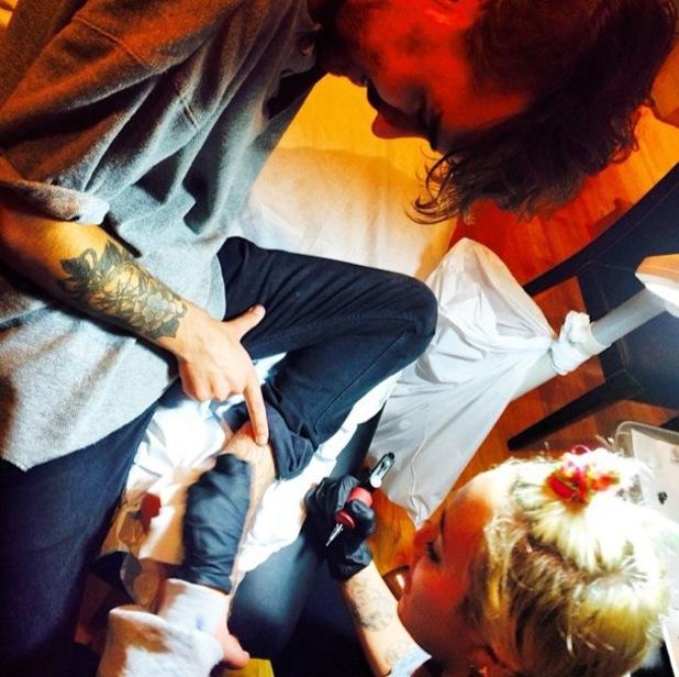 Miley Cyrus tattoos friend Cheyne Thomas, Instagram 27 July