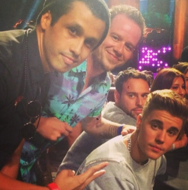 O-Town's Erik-Michael Estrada and Jacob Underwood sit next to Justin Bieber and his manager Scooter Braun at the Young Hollywood Awards in Los Angeles. 27 July 2014.