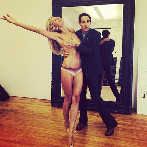 Heidi Klum poses topless with designer Zac Posen protecting her modesty, 31 July 2014