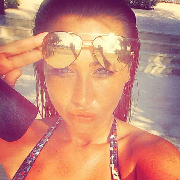 Lauren Goodger takes a selfie in the sun, 29 July 2014