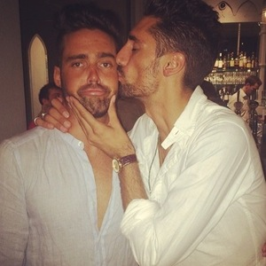 Made In Chelsea star Spencer Matthews gets birthday kiss from Hugo Taylor. 6 August 2014.