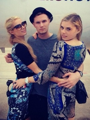 Paris Hilton flies back to Ibiza with her brother, August 2014.