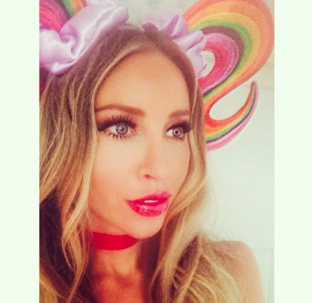 Lauren Pope poses wearing doll make-up, Mac lip liner and Barry M lip paint, 5 August 2014