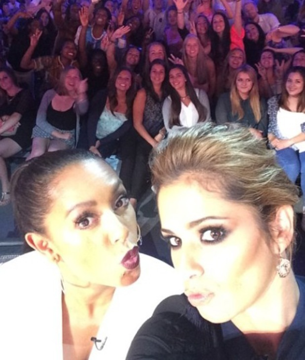 X Factor judges Cheryl Cole and Mel B pose for a selfie on the panel (3 August).